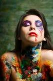 Pinte a la mujer Imagen de archivo libre de regalías