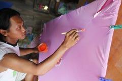 Pinte la ropa para mujer Imagen de archivo libre de regalías