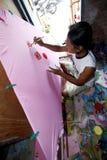 Pinte la ropa para mujer Imágenes de archivo libres de regalías