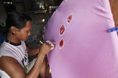Pinte la ropa para mujer Fotografía de archivo