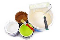 Pinte las latas y la brocha Imágenes de archivo libres de regalías