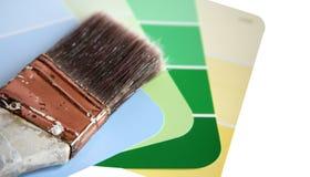 Pinte las muestras con el cepillo de pintura usado Fotografía de archivo libre de regalías