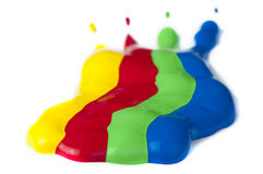 Pinte revestido en el papel. Colores rojos, verdes, azules y amarillos. foto de archivo libre de regalías