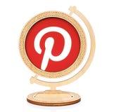 Pinterest circle icon placed into wooden globe. Kiev, Ukraine - November 01, 2017: Pinterest circle icon printed on paper and placed into wooden globe on white Stock Images