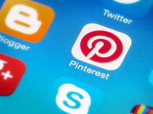 Pinterest icon on smartphone. HILVERSUM, NETHERLANDS - JANUARY 15, 2014: Pinterest is a pinboard-style photo-sharing website that allows users to create and royalty free stock photography