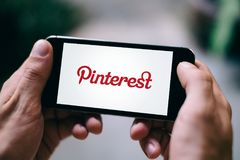 BERLIN, GERMANY - MARCH 23, 2018: Closeup of iPhone Screen with PINTEREST APP LOGO or ICON. Pinterest is a social network where users can attach picture stock photos