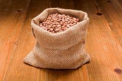 Pinto beans in burlap bag Royalty Free Stock Photos