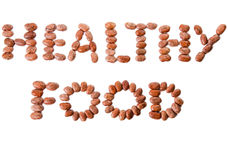 Pinto beans spelling HEALTHY FOOD. Dried beans spelling these words Stock Images