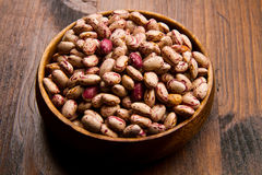 Pinto beans on wood bowl Royalty Free Stock Image