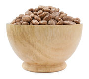 Pinto beans on wood cup isolated Stock Images