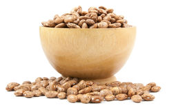 Pinto beans on wood cup isolated Stock Image