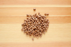Pinto beans on wood Stock Photography
