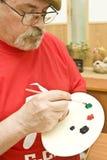 Pintor com pálete da cor foto de stock royalty free