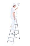 Pintor con el rodillo y la escalera de pintura Imagen de archivo