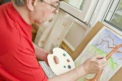 Pintor con la pintura fotos de archivo