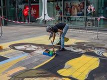 Pintor da rua no trabalho Fotografia de Stock
