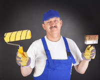 Pintor de casas alegre Imagen de archivo libre de regalías