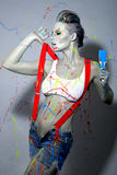 Pintor de casas de sexo femenino Splattered con la pintura de látex Fotografía de archivo libre de regalías