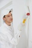 Pintor de casas en el trabajo imagenes de archivo
