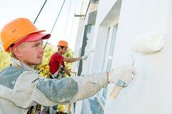 Pintor de la fachada del constructor en el trabajo Fotografía de archivo libre de regalías