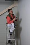 Pintor em um trabalho fotografia de stock royalty free