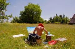 Pintor en campo Fotos de archivo