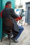 Pintor público en la colina de Montmartre en París Imágenes de archivo libres de regalías