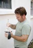 Pintor que mergulha a escova Imagem de Stock