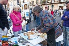 Pintor que trabaja en la plaza Navona, Roma Fotografía de archivo libre de regalías