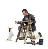 Pintor y perrito Imagenes de archivo