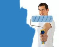 Pintor y su rodillo azul foto de archivo