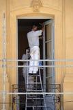 Pintores de casa en el trabajo Fotos de archivo libres de regalías