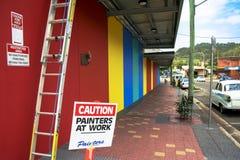Pintores do cuidado no sinal do trabalho Imagens de Stock