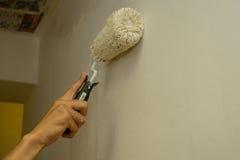 Pintores para pintar la pared Imagen de archivo libre de regalías