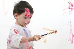 Pintura adorable del muchacho del niño sobre el vidrio fotos de archivo libres de regalías