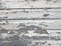 Pintura agrietada en la madera Imagenes de archivo
