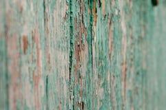 Pintura agrietada en la textura de madera de la pared imágenes de archivo libres de regalías