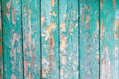 Pintura agrietada en la textura de madera de la pared imagenes de archivo