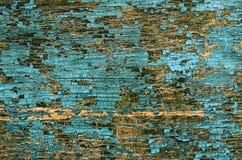 Pintura agrietada vieja en una superficie de madera imagen de archivo libre de regalías