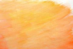 Pintura anaranjada abstracta de la mano del arte de la acuarela en el fondo blanco, fondo de la acuarela Imagenes de archivo