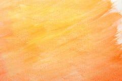 Pintura anaranjada abstracta de la mano del arte de la acuarela en el fondo blanco, fondo de la acuarela Fotografía de archivo