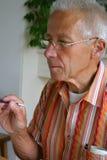 Pintura aposentada do homem imagem de stock royalty free