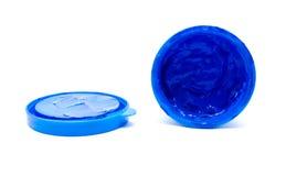 Pintura azul da cor em um frasco no fundo branco Imagem de Stock Royalty Free