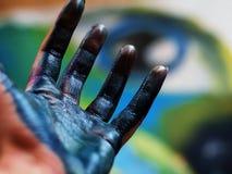 Pintura azul da mão foto de stock