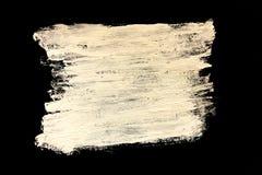 Pintura blanca en un fondo negro, textura imagen de archivo