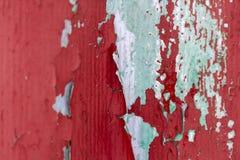 Pintura ciánica roja vieja en la pared Imagen de archivo