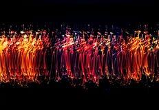 Pintura clara multicolorido louca no fundo escuro foto de stock