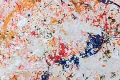 Pintura colorida en el fondo de madera Foto de archivo libre de regalías