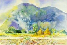 Pintura colorido de la montaña y de la paja con humo en colina Imagen de archivo
