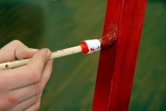 Pintura com uma escova Imagens de Stock